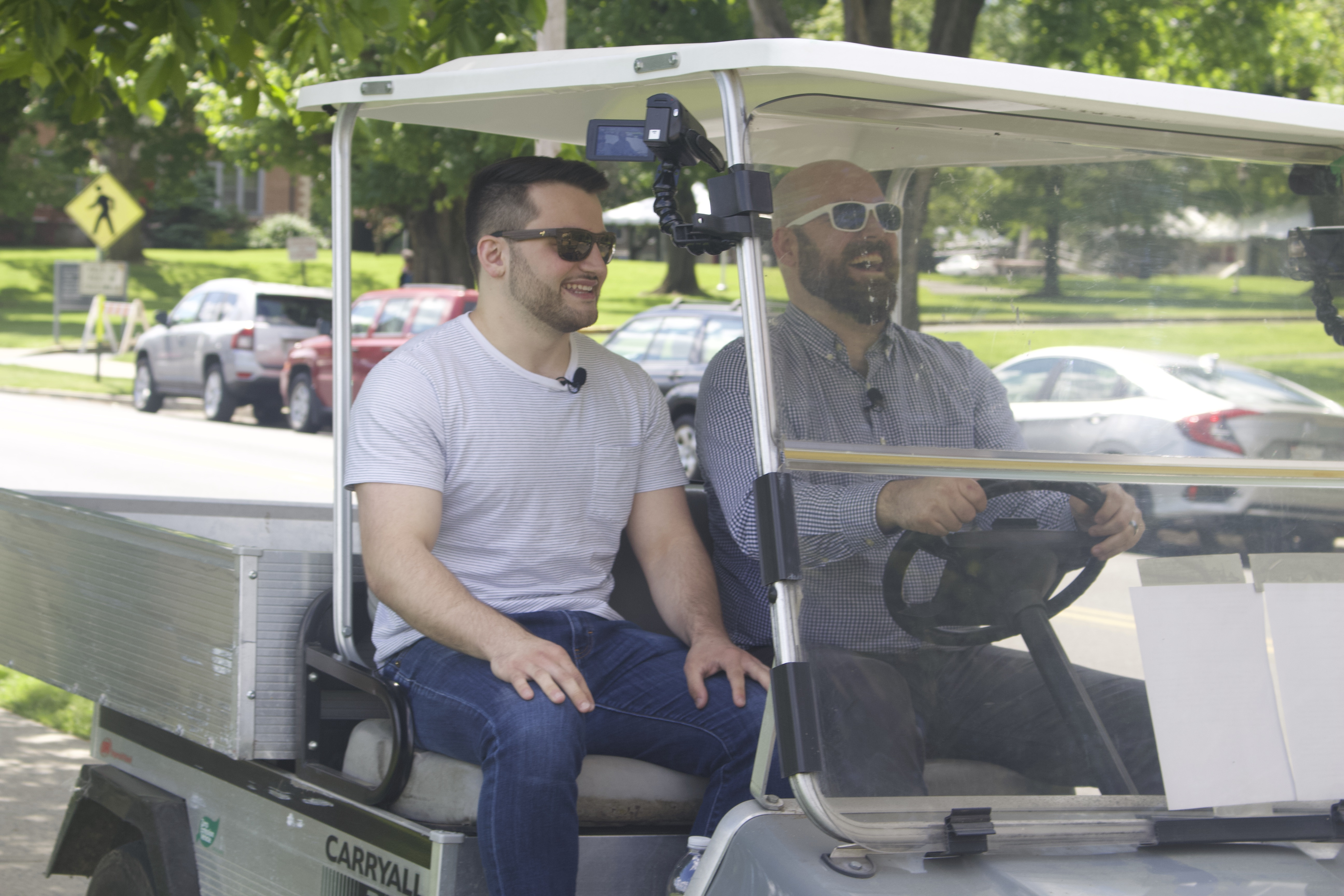 Image for Anthony and Tony talk and travel around campus in a golf cart in this image from the filming of episode 2.